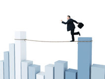 Smart business. Businessman run on rope with financial chart background Stock Photos