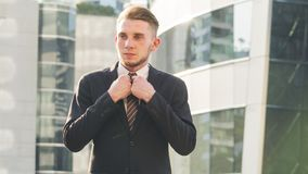 Smart business confident man stand and dress up the suite at the Stock Photos