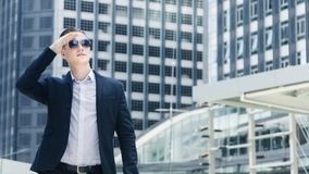 Smart business confident man stand at the outdoor. Public space with modern building background Stock Photos