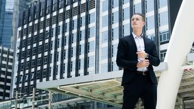 Smart business confident man stand at the outdoor. Public space with modern building background Royalty Free Stock Photo