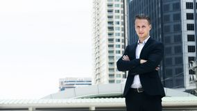 Smart business confident man stand at the outdoor public space w. The smart business confident man stand at the outdoor public space with modern building Stock Images