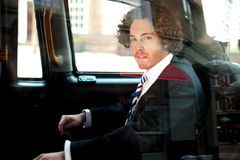 Smart business executive inside taxi cab Royalty Free Stock Photography