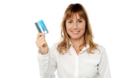 Smart business lady holding credit card Royalty Free Stock Image