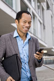 Smart business male with mobile outside Royalty Free Stock Photos