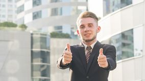 The smart business man is feeling happy and thump up at the outd Stock Images