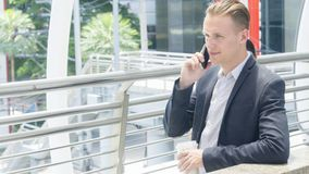 Smart business man hold the smartphone and talk. The smart business man hold the smartphone and talk Stock Photos