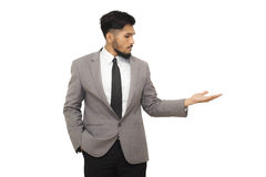 Smart business man presenting your product royalty free stock image