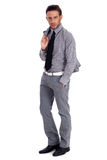 Smart business man standing with his suit Stock Images
