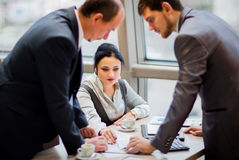 Smart business partners communicating at meeting Royalty Free Stock Photo