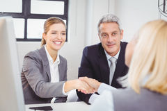 Smart business people handshaking with client Stock Photography