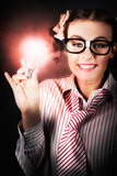 Smart Business Person Holding Light Bulb In Hand. Intelligent Nerd Girl Holding A Illuminated Light Bulb In A Brainy Depiction Of A New Business Innovation Stock Images