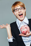 Smart business woman euphoric with her piggy bank Stock Images