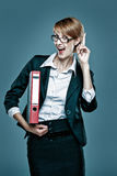 Smart business woman with folder gesturing Stock Images