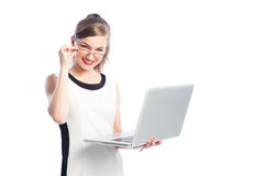 Smart business woman with glasses holding laptop. Smart business woman with glasses holding open laptop isolated on white background Stock Photos