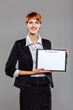 Smart business woman holding a clipboard Stock Image