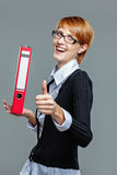 Smart business woman holding a folder and showing thumb up Stock Image