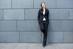 Smart business woman leaning on Royalty Free Stock Photography