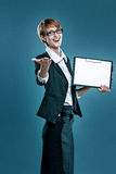 Smart business woman presenting a clipboard and gesturing Royalty Free Stock Photo