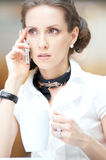 Smart business woman talking on the phone Royalty Free Stock Image
