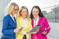 Smart business women looking at tablet Stock Photo
