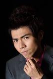 Smart businessman. Closeup portrait of Asian man in dark background Royalty Free Stock Image