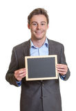 Smart businessman with chalkboard Stock Image