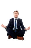 Smart businessman doing meditation Royalty Free Stock Photo