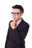 Smart businessman with eyeglasses thinking and looking at you Stock Image