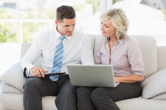 Smart businessman and his secretary with diary and laptop Royalty Free Stock Photography