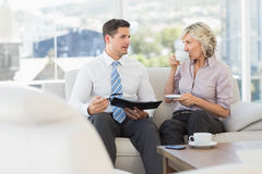 Smart businessman and his secretary  with diary and tea cup Royalty Free Stock Photos