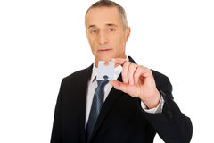 Smart businessman holding a puzzle stock photo