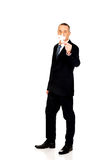 Smart businessman holding a puzzle stock photos