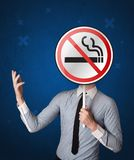 Businessman holding no smoking sign. Smart businessman holding round sign with no smoking graphic stock photography