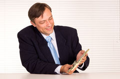 Smart businessman with money Stock Image