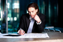 Smart businessman projecting his plans stock images