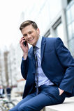 Smart businessman talking in his mobile phone Stock Photos