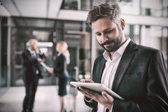 Smart businessman using digital tablet Royalty Free Stock Images