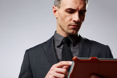 Smart businessman using tablet computer Stock Image