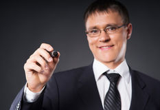 A smart businessman writing with a marker Royalty Free Stock Images
