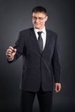 A smart businessman writing with a marker Royalty Free Stock Image