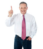 Smart businessperson pointing upwards Stock Image