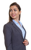 Smart businesswoman with brown hair looking around royalty free stock images