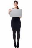 Smart businesswoman holding a laptop Stock Photos