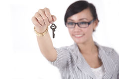 Smart Businesswoman with a Key. Beautiful Asian Business Woman offers the key of success Stock Images
