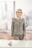 Smart businesswoman in office Stock Images