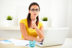 Smart businesswoman sitting in her room Royalty Free Stock Photography