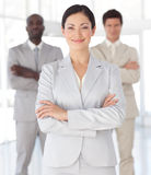 Smart Businesswoman with two associates. 1 royalty free stock image