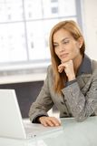 Smart businesswoman working on computer Royalty Free Stock Photography