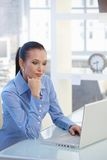Smart businesswoman working on laptop computer Royalty Free Stock Photos