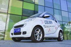 Smart car with advertising against a green building, Beijing, China Royalty Free Stock Images